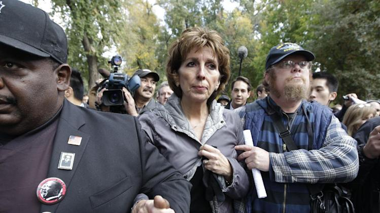 FILE - This Nov. 21, 2011 file photo shows University of California, Davis Chancellor Linda Katehi, center,  as she is escorted from the stage after she spoke during a rally on campus in Davis, Calif., after police pepper-sprayed peaceful demonstrators during a protest near the same spot. A University of California task force said Wednesday that UC Davis police should not have used pepper-spray on student demonstrators in an incident that prompted national outrage and calls for the chancellor's resignation. The task force also attributed the response to breakdowns in the campus chain of command, from Katehi to police Chief Annette Spicuzza to Lt. John Pike, the main officer shown in the widely viewed online videos. (AP Photo/Paul Sakuma, File)
