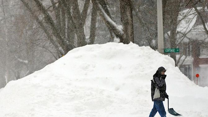 Brian Tinker, 14, walks to a friends house across East Main Street in West Brookfield, Mass., in the aftermath of an overnight storm on Saturday, Feb. 9, 2013. (AP Photo/Worcester Telegram & Gazette, Tom Rettig)