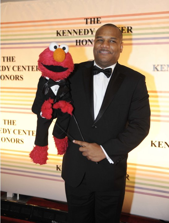 "FILE - This Dec. 4, 2011 file photo shows ""Sesame Street"" character Elmo and puppeteer Kevin Clash arrive at the Kennedy Center for the Performing Arts for the Kennedy Center Honors gala performance i"