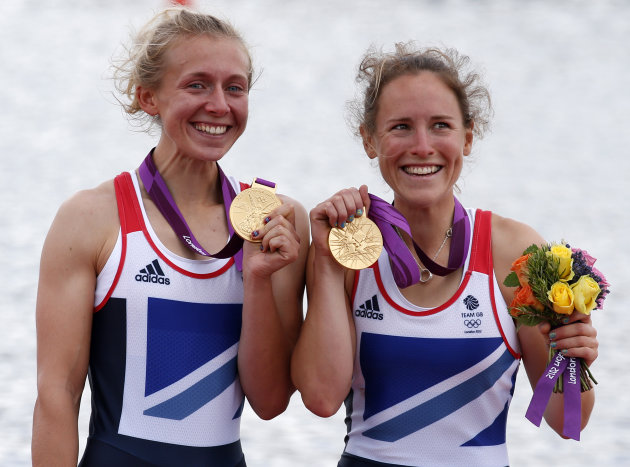 Gold medallists Katherine Copeland and Sophie Hosking of Britain celebrate during the award ceremony for the women's lightweight double sculls final during the London 2012 Olympic Games