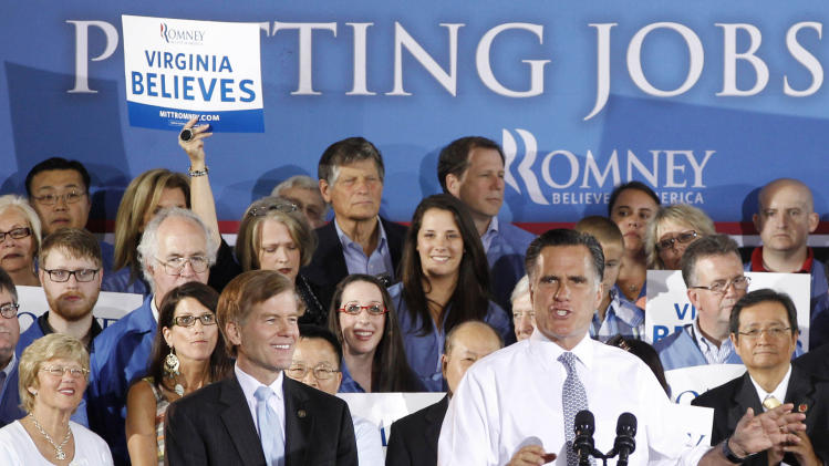 """FILE - In this June 27, 2012, file photo Republican presidential candidate Mitt Romney speaks at a """"Putting Jobs First"""" campaign rally in Sterling, Va., with Virginia Gov. Bob McDonnell, center left. When you vote in November 2012, you'll be voting for more than a president; you'll be casting a ballot for and against a checklist of policies that touch your life and shape the country you live in. It can be hard to see through the process that the election is a contest of actual ideas, but it is always so. A candidate's words connect to deeds in office. (AP Photo/Charles Dharapak, File)"""