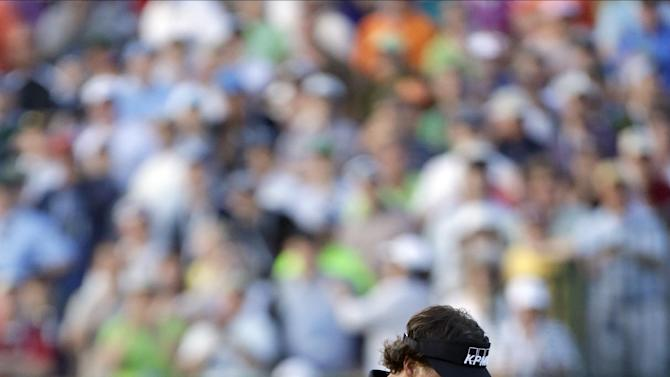 Phil Mickelson reacts after missing a shot on the 18th hole during the fourth round of the U.S. Open golf tournament at Merion Golf Club, Sunday, June 16, 2013, in Ardmore, Pa. (AP Photo/Julio Cortez)