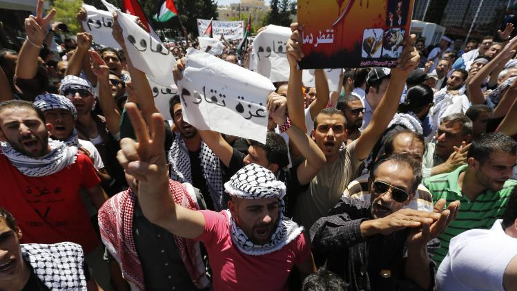 Jordanian protesters shout slogans during a demonstration to calling for an end to the Israeli offensive in the Gaza Strip, in Amman