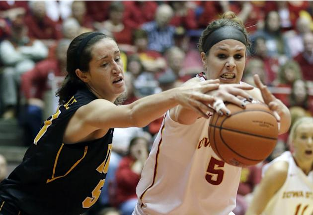 Iowa center Bethany Doolittle, left, fights for a rebound with Iowa State forward Hallie Christofferson during the first half of an NCAA college basketball game, Thursday, Dec. 12, 2013, in Ames, Iowa
