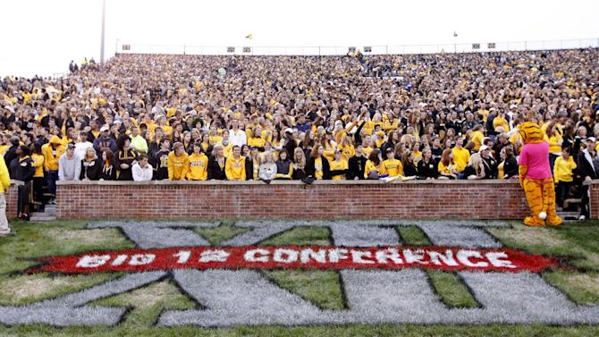 FILE - In this Sept. 17, 2011 file photo, a Big 12 Conference logo is shown during the first quarter of an NCAA college football game between the Missouri and the Western Illinois in Columbia, Mo. Missouri has taken another step toward leaving the Big 12 Conference and there is interest in the SEC in taking the Tigers. The governing curators at Missouri unanimously gave Chancellor Brady Deaton the authority Friday, Oct. 21, 2011, to move the school out of the Big 12 if he decides that is in the school's best interest. He gave no timeline for a decision but indicated that a move, if it happens, would not take much longer. (AP Photo/Jeff Roberson, File)