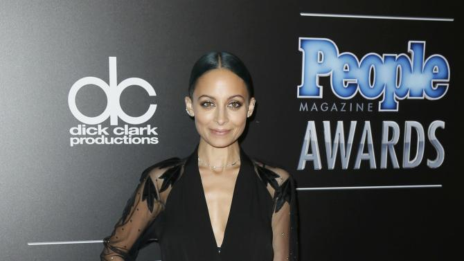 Fashion designer Nicole Richie arrives at the People Magazine Awards in Beverly Hills