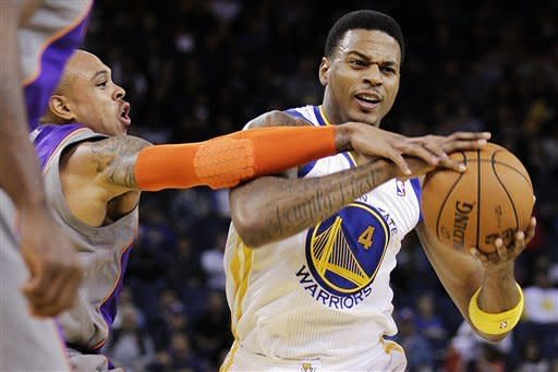 Curry-less Warriors beat Suns 107-92