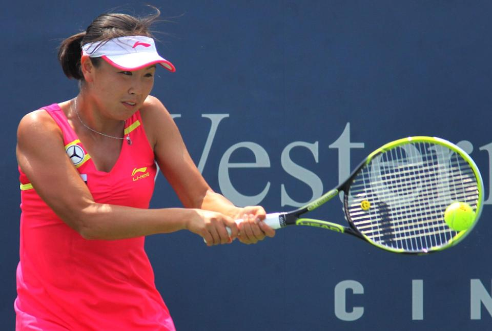 Shuai Peng, of China, returns a shot to Petra Kvitova, of the Czech Republic, during a match at the Western & Southern Open tennis tournament, Thursday Aug. 16, 2012, in Mason, Ohio. (AP Photo/Tom Uhlman)