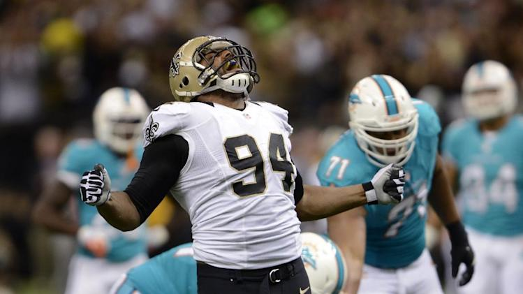 New Orleans Saints defensive end Cameron Jordan (94) celebrates a sack in the second half of an NFL football game against the Miami Dolphins in New Orleans, Monday, Sept. 30, 2013