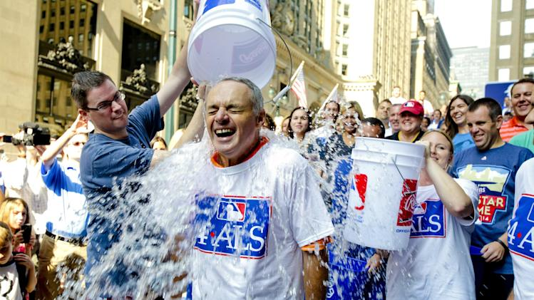 FILE - This Aug. 20, 2014 file photo shows Major League Baseball Commissioner-elect Rob Manfred participating in the ALS Ice-Bucket Challenge outside the organization's headquarters in New York. Manfred participated with more than 160 other MLB employees to raise more than $16,000 for the ALS Association. The phenomenal success of the fundraising craze is making charitable organizations rethink how they connect with a younger generation of potential donors, specifically through social media. (AP Photo/Vanessa A. Alvarez, File)