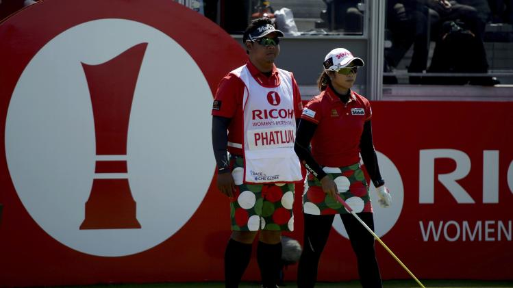 Pornanong Phatlum of Thailand prepares to tee off at the first hole during the women's British Open golf tournament at Royal Birkdale Golf Club
