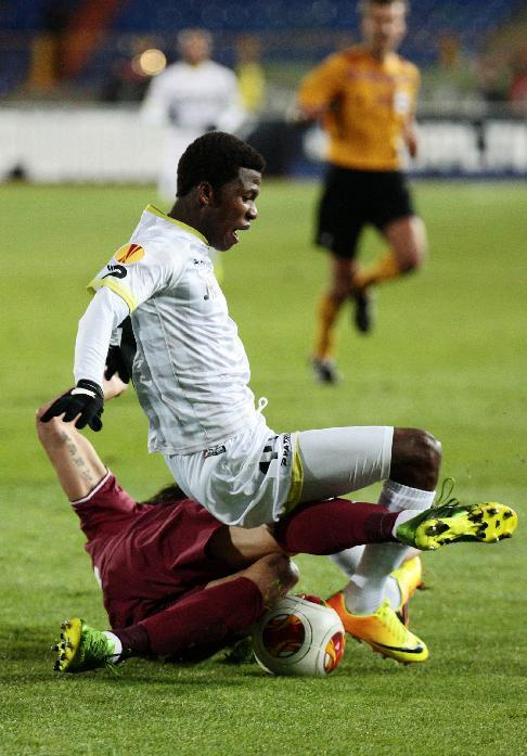 Rubin Kazan's Cesar Navas, on the ground, and Zulte Waregem's Ibrahima Conte fight for the ball during their Europa League Group D soccer match in Kazan, Russia, Thursday, Oct. 3, 2013