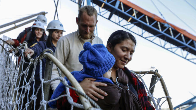 Hannah Gastonguay, holding her baby Rahab, is followed by her husband Sean and the couple's 3-year-old daughter Ardith, as they disembark in the port city of San Antonio, Chile, Friday, Aug. 9, 2013. The northern Arizona family was lost at sea for weeks in an ill-fated attempt to leave the U.S. over what they consider government interference in religion. But just weeks into their journey the Gastonguays hit a series of storms that damaged their small boat, leaving them adrift for weeks. They were eventually picked up by a Venezuelan fishing vessel, transferred to a Japanese cargo ship and taken to Chile where they are resting in a hotel in San Antonio. (AP Photo/Las Ultimas Noticias)