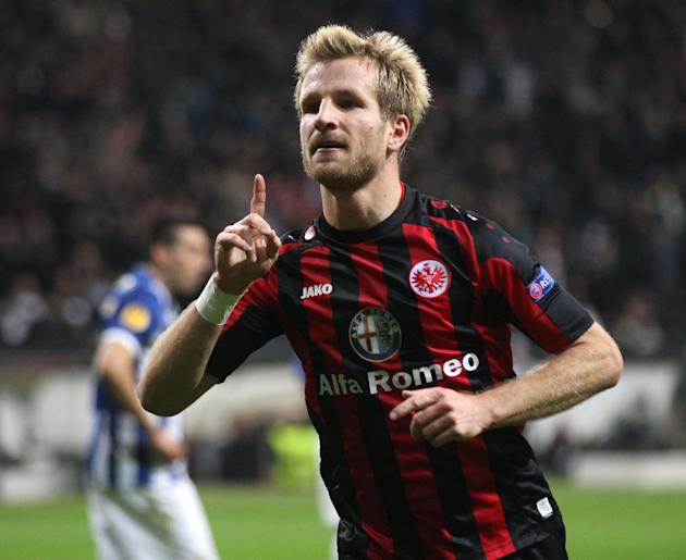 Frankfurt's Stefan Aigner celebrates his side's opening goal during a Europa League round of 32 second leg soccer match between Eintracht Frankfurt and FC Porto in Frankfurt, Germany, Thursday