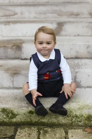Britain's Prince George poses in a courtyard at Kensington Palace in London in this one out of three official Christmas photographs of him