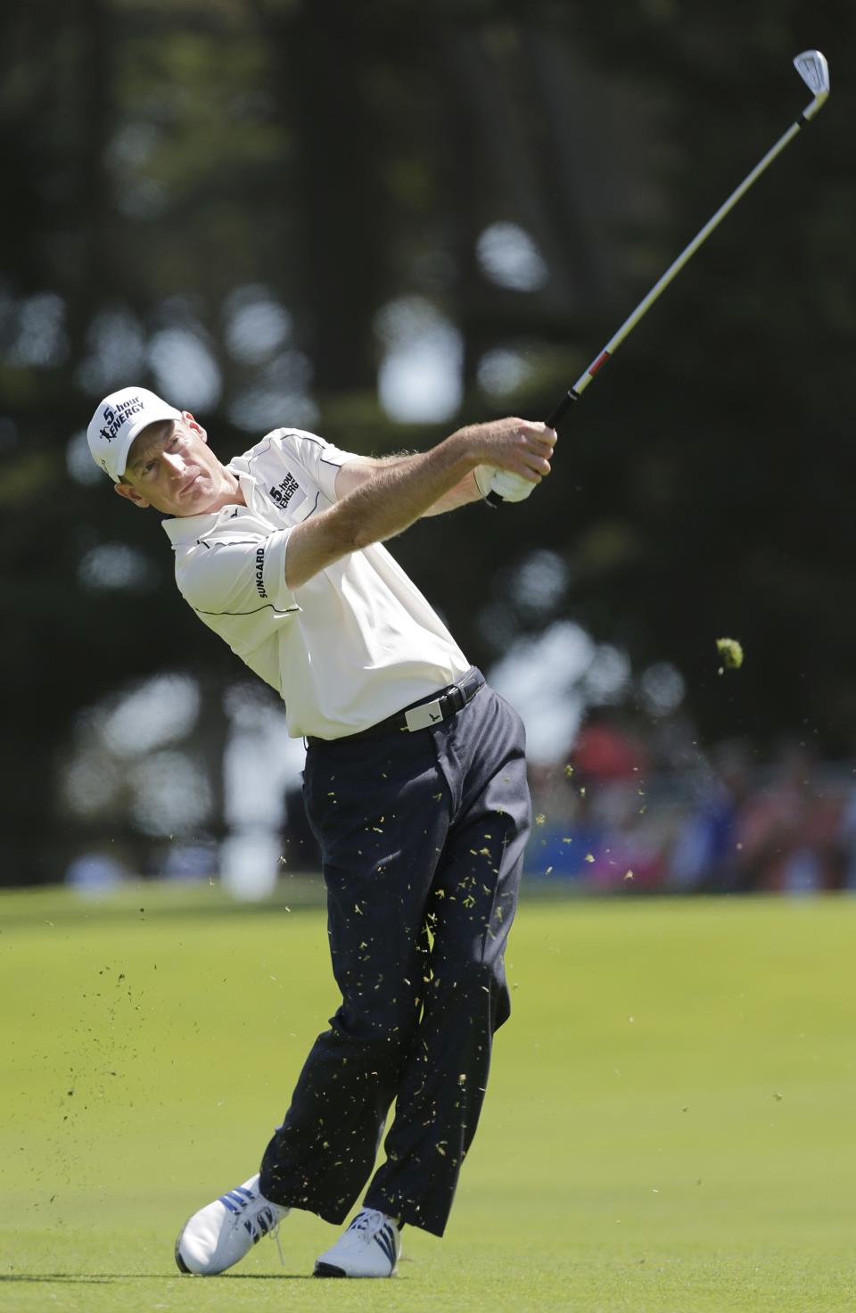 Jim Furyk hits a shot on the first hole during the third round of the U.S. Open Championship golf tournament Saturday, June 16, 2012, at The Olympic Club in San Francisco. (AP Photo/Eric Gay)
