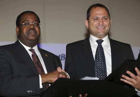 Onasanya, managing director of First Bank of Nigeria, and Dahan, PayPal's regional director of Israel and Africa shake hands at the announcement of a partnership between First Bank of Nigeria and PayPal, in Lagos
