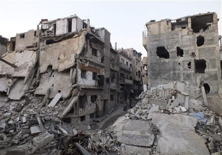 A general view shows damaged buildings on a deserted street in the besieged area of Homs
