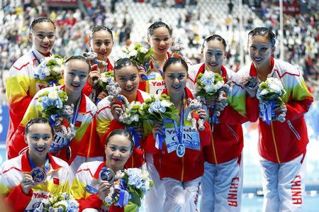 Members of team China pose with their silver medals after the women's synchronised swimming free routine combination final at the Aquatics World Championships in Kazan