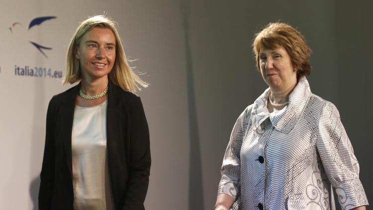 Italian Minister of Foreign Affairs Federica Mogherini, left, is followed by EU foreign policy chief Catherine Ashton as they arrive for a press conference at the end of an informal meeting of the EU Foreign Affairs Ministers, in Milan, Italy, Saturday, Aug. 30, 2014. European Union leaders are set to decide who will be the 28-nation bloc's foreign policy chief for the next five years, with Italy's top diplomat Mogherini widely seen as the front-runner for the prestigious job. The decision on incumbent Ashton's successor comes as the crisis at the EU's eastern border pitting Ukraine against Russia poses one of the biggest foreign policy challenges for the bloc in decades. (AP Photo/Luca Bruno)