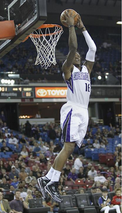 Sacramento Kings guard Ben McLemore does a reverse stuff against the Phoenix Suns during the fourth quarter of an NBA preseason basketball game in Sacramento, Calif., Thursday, Oct. 17, 2013.  The Kin