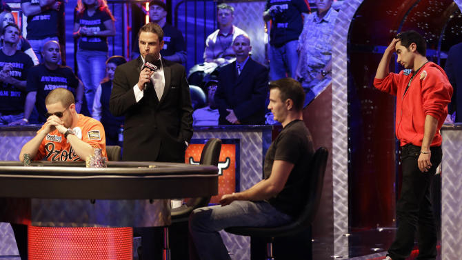 Greg Merson, left, Andras Koroknai, center, of Debrecen Hungary, and Jesse Sylvia watch the flop during the World Series of Poker Final Table event, Monday, Oct. 29, 2012, in Las Vegas.  Merson won the pot and Koroknai was eliminated. (AP Photo/Julie Jacobson)