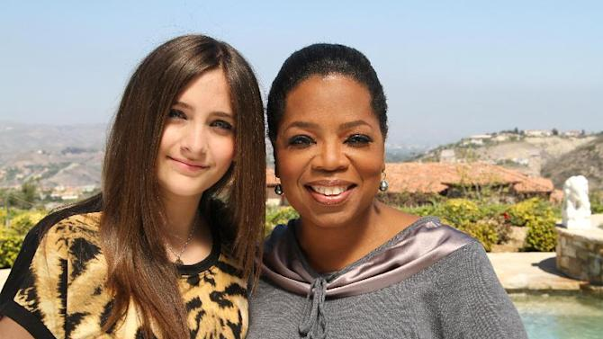 """This undated image released by Harpo, Inc. shows host Oprah Winfrey posing with Paris Jackson, daughter of the late pop icon Michael Jackson in Los Angeles. Winfrey interviewed Jackson for """"Oprah's Next Chapter,"""" airing Sunday, June 10 at 9:00 a.m. EST on OWN. (AP Photo/Harpo Inc., George Burns)"""