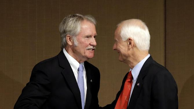 File--In this Oct. 10, 2014, file photo, Oregon Democratic Gov. John Kitzhaber, left, shakes hands with Republican challenger Dennis Richardson after their gubernatorial debate in Portland, Ore.  Kitzhaber's re-election bid is one of Oregon's top 2014 stories.(AP Photo/Don Ryan, file)