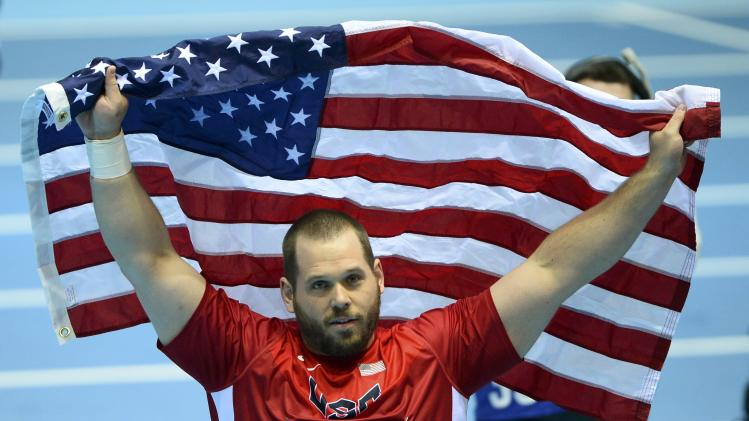 Whiting of the U.S. celebrates after winning gold in men's shot put final at world indoor athletics championships in Sopot