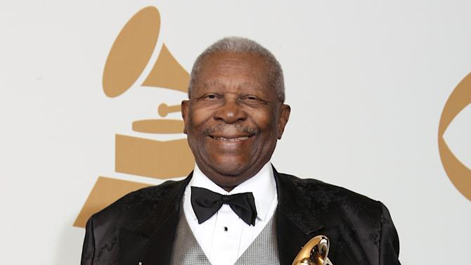 "FILE - In this Feb. 8, 2009, file photo, B.B. King poses backstage with his award for Best Traditional Blues Album for ""One Kind Favor"" at the 51st Annual Grammy Awards in Los Angeles. A funeral director says he's prepared for lines around the block for a public viewing of blues legend King on Friday, May 22, 2015, in Las Vegas. A procession on the following Wednesday will mark King's return to Beale Street in Memphis, Tenn., before a final road trip to Indianola, Miss., and burial May 29. (AP Photo/Matt Sayles, File)"