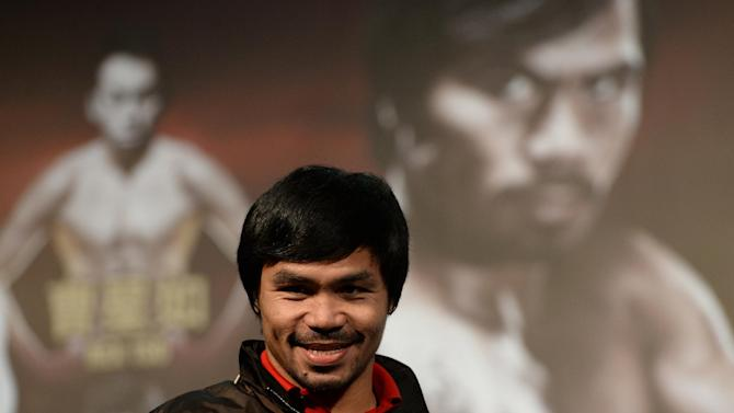 Philippine boxing icon Manny Pacquiao attends a pre-fight press conference in Macau, on August 25, 2014