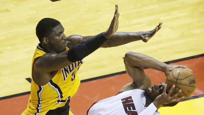 Miami Heat shooting guard Dwyane Wade (3) shoots under pressure from Indiana Pacers center Roy Hibbert (55) during the first half of Game 7 in their NBA basketball Eastern Conference finals playoff series, Monday, June 3, 2013 in Miami. (AP Photo/Wilfredo Lee)