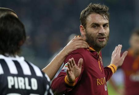 AS Roma's De Rossi reacts after receiving a red card during their Italian Serie A soccer match against Juventus at the Juventus stadium in Turin