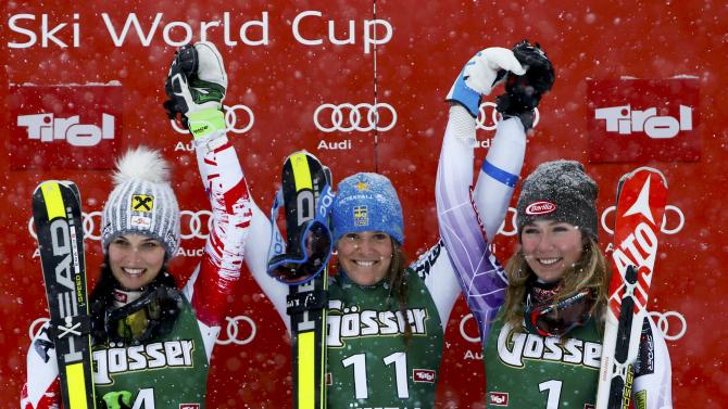 Fenninger from Austria, Hector from Sweden and Shiffrin from the U.S. react after the World Cup Women's Giant Slalom race in Kuehtai ski resort