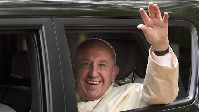 Pope Francis waves from his vehicle after leading a Holy Mass for the Martyrs of Uganda at the area of the Catholic Sanctuary in the Namugongo area of Kampala, Uganda Saturday, Nov. 28, 2015. Pope Francis is in Uganda on his first-ever trip to Africa, a six-day pilgrimage that has already taken him to Kenya and then onwards to the Central African Republic. (AP Photo/Ben Curtis)