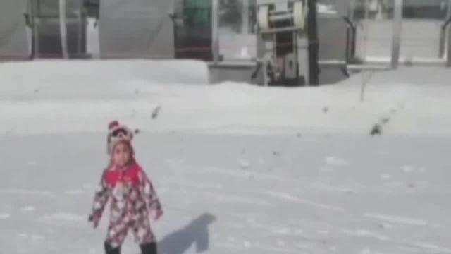 Snowboarding toddler