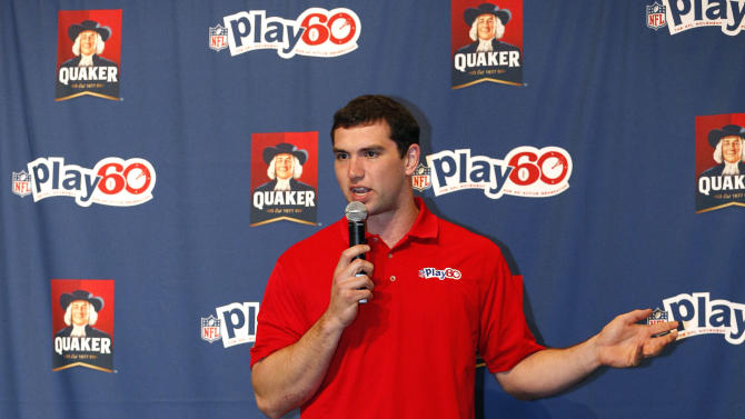 Indianapolis Colts quarterback Andrew Luck talks to New Orleans children about the importance of eating healthy at the Quaker's NFL Experience in New Orleans on Wednesday, Jan. 30, 2013. (Jonathan Bachman / AP Images for Quaker Oats)