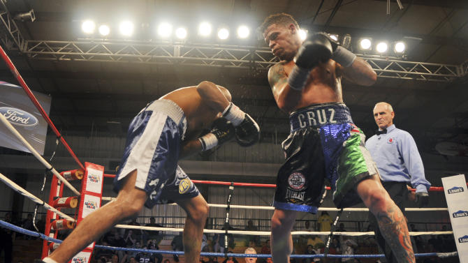 """In this photo taken Feb. 10, 2012 and provided by Event Marketing & Communications, boxer Orlando Cruz, right, battles Alejandro Delgado during a fight at the Palm Bay Community Center in Palm Bay, Fla. Describing himself as """"a proud gay man,"""" Puerto Rican featherweight Orlando Cruz on Thursday, Oct. 4, 2012, became what is believed to be the first pro boxer to come out as openly homosexual while still competing. (AP Photo/Event Marketing & Communications, Reynaldo Sanchez)"""