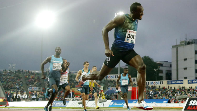 Usain Bolt of Jamaica competes in and wins the men's 200 metres during the Diamond League athletics competition at the Bislett Stadium in Oslo, Thursday June 13, 2013. (AP Photo/NTB Scanpix, Cornelius Poppe)  NORWAY OUT