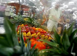 A customer shops along the fruits department in a Sam's Club store, a division of Wal-Mart Stores, in Bentonville