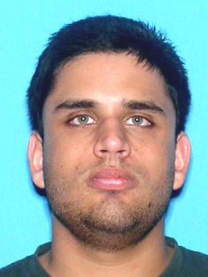 In this undated photograph released by the University of Central Florida in Orlando, Fla., shows shows James Seevakumaran. University of Central Florida police have identified Seevakumaran as the student that killed himself in a dorm at UCF in Orlando, Fla., early Monday March 18, 2013. Seevakumara was found with several fire arms and a homemade device in a backpack. The incident caused the evacuation of a dorm building. (AP Photo/Florida Highway Patrol)
