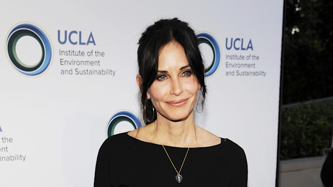 """FILE - This March 21, 2014 file photo shows actress Courteney Cox at the UCLA Institute of the Environment and Sustainability's An Evening of Environmental Excellence in Beverly Hills, Calif. Cox will premiere her directorial debut """"Just Before I Go"""" at the Tribeca Film Festival on Thursday, April 24. (Photo by Chris Pizzello/Invision/AP, File)"""
