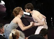 "Anne Hathaway (R) is congratulated by fellow nominee Amy Adams as she was announced as the winner of the award for best supporting actress for her role in ""Les Miserables"" at the 85th Academy Awards in Hollywood, California February 24, 2013. REUTERS/Mario Anzuoni"