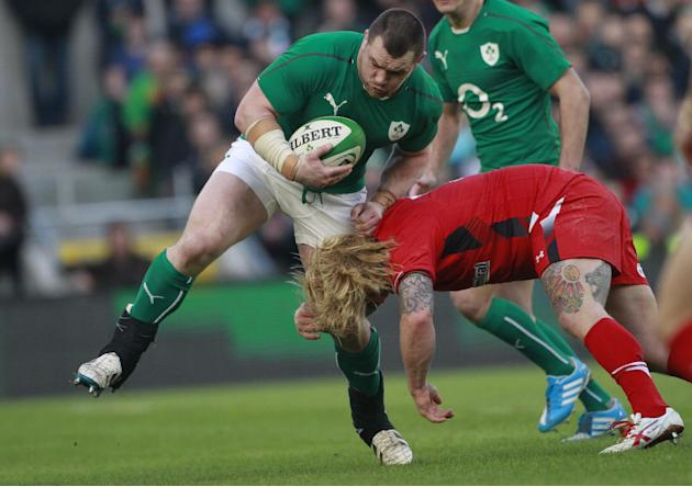 Ireland's Cian Healy, centre, is tackled by Wales' Richard Hibbard during their Six Nations Rugby Union international match at the Aviva Stadium, Dublin, Ireland, Saturday, Feb. 8, 2014. (AP P