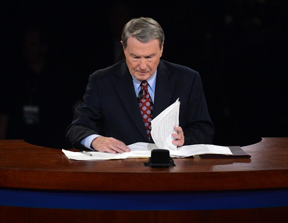 Moderator Jim Lehrer looks over his notes before the first presidential debate at the University of Denver, Wednesday, Oct. 3, 2012, in Denver. (AP Photo/Pool-Michael Reynolds)