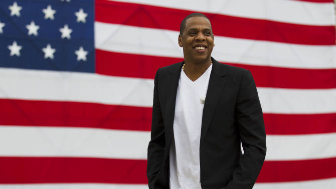 """Entertainer Shawn """"Jay-Z"""" Carter smiles in between interviews, after a news conference at Philadelphia Museum of Art, Monday, May 14, 2012, in Philadelphia. The rapper announced plans for a two-day music festival in Philadelphia's at Fairmount Park, featuring nearly 30 acts """"that embody the American spirit"""" on Labor Day weekend, Sept. 1 and Sept. 2, 2012. (AP Photo/Matt Rourke)"""