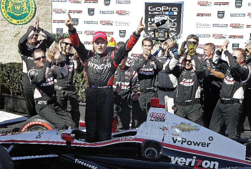 Ryan Briscoe of Australia celebrates after winning the IndyCar Series auto race Sunday, Aug. 26, 2012, in Sonoma, Calif. (AP Photo/Ben Margot)