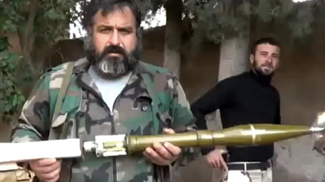 In this image taken from video obtained from the Ugarit News, which has been authenticated based on its contents and other AP reporting, the Union of Syria's Victory Battalions prepare a rocket in Aleppo, Syria, on Monday, Nov. 26, 2012. (AP Photo/Ugarit News via AP video)