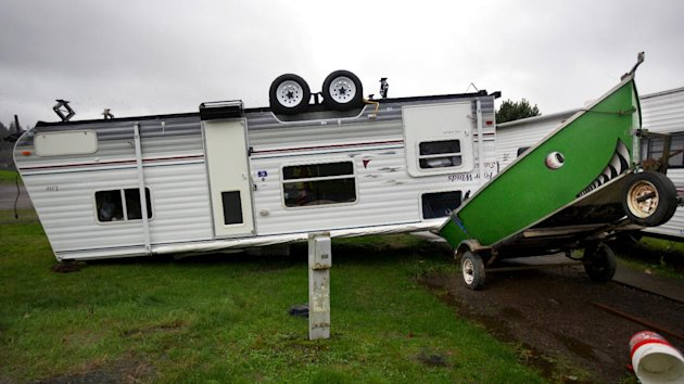 A camp trailer is left upside down at the Old Mill Marina trailer park in Garibaldi, Ore., after high winds and rain hit the Oregon coast on Monday, Nov. 19, 2012. The trailer was unoccupied when it f