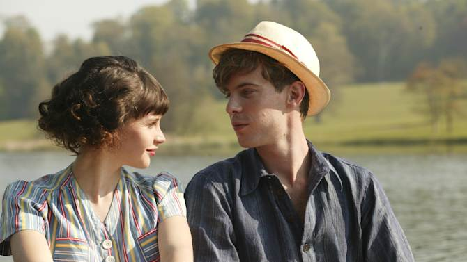 """This film image released by IFC Films shows Felicity Jones as Dolly Thatchum, left, and with Luke Treadway as Joseph Pattern in a scene from """"Cheerful Weather for the Wedding."""" (AP Photo/IFC Films, Suzie Blake)"""